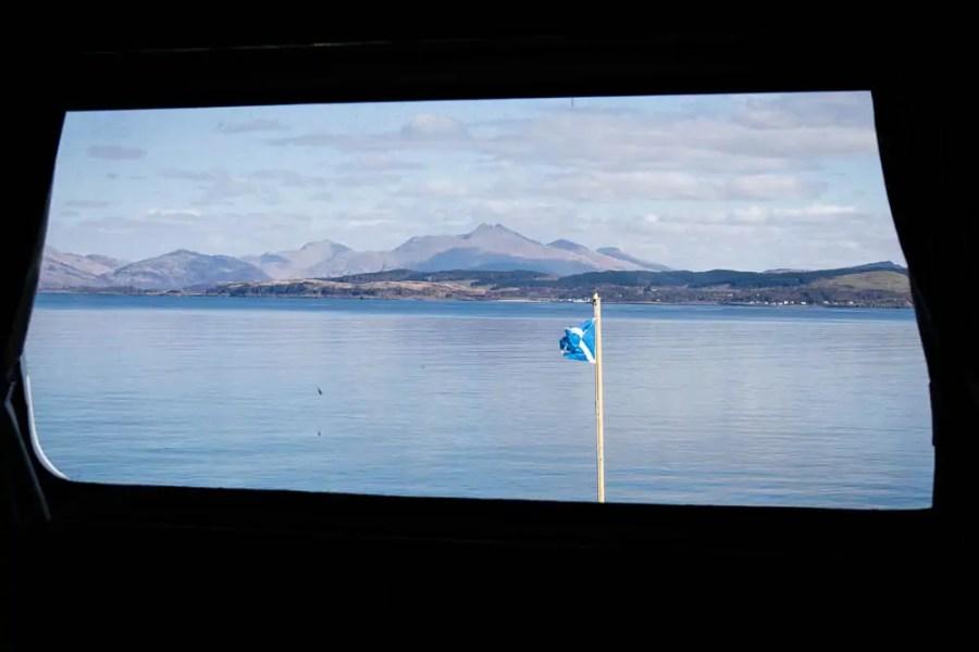 The Scottish mountains through the window of a Calmac ferry.
