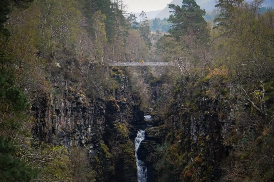 North Coast 500: A tiny human standing above Corrieshalloch Gorge