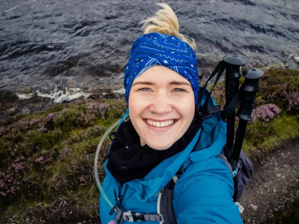 Travel blogger Kathi is appropriate hiking equipment for a trip to Scotland.