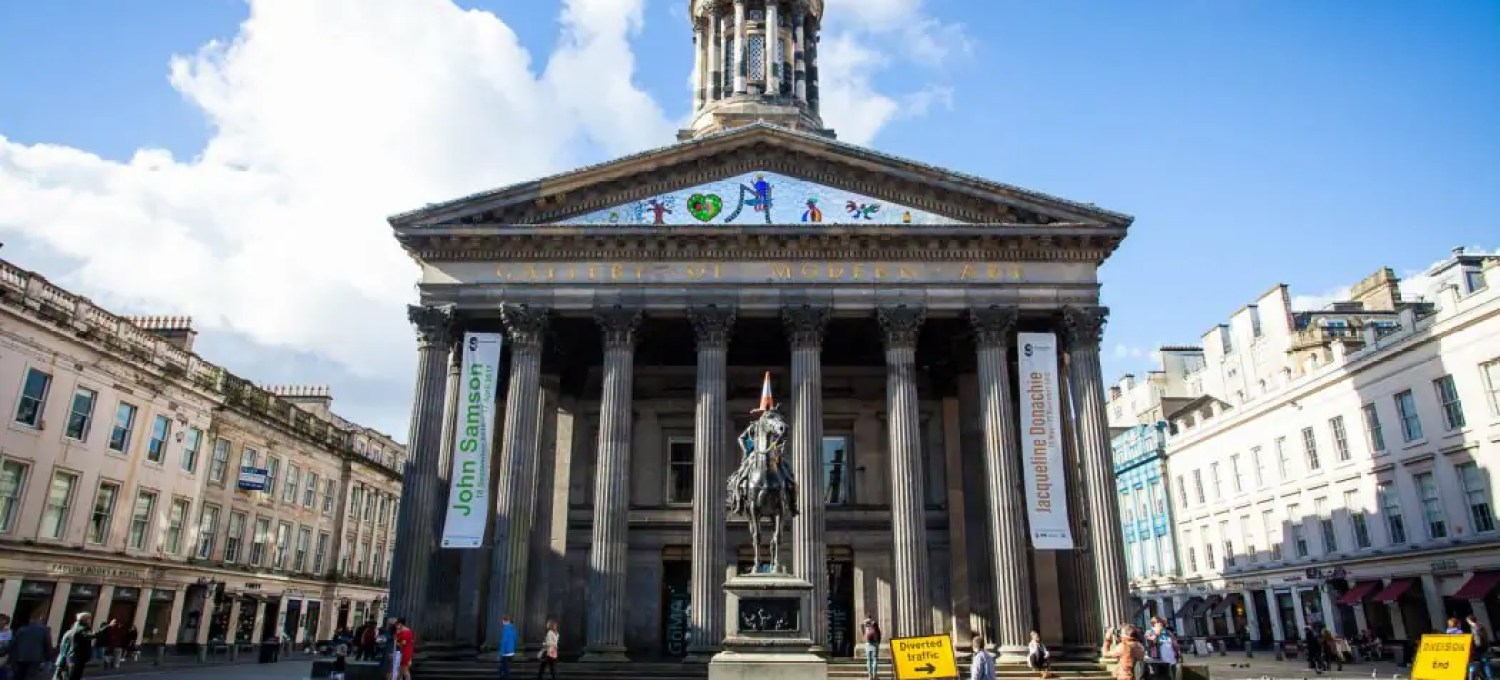 The Gallery of Modern Art and the Duke of Wellington statue in Glasgow.