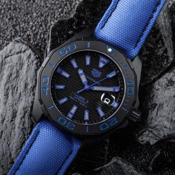 Tag Heuer Aquaracer 300M Black Titanium background