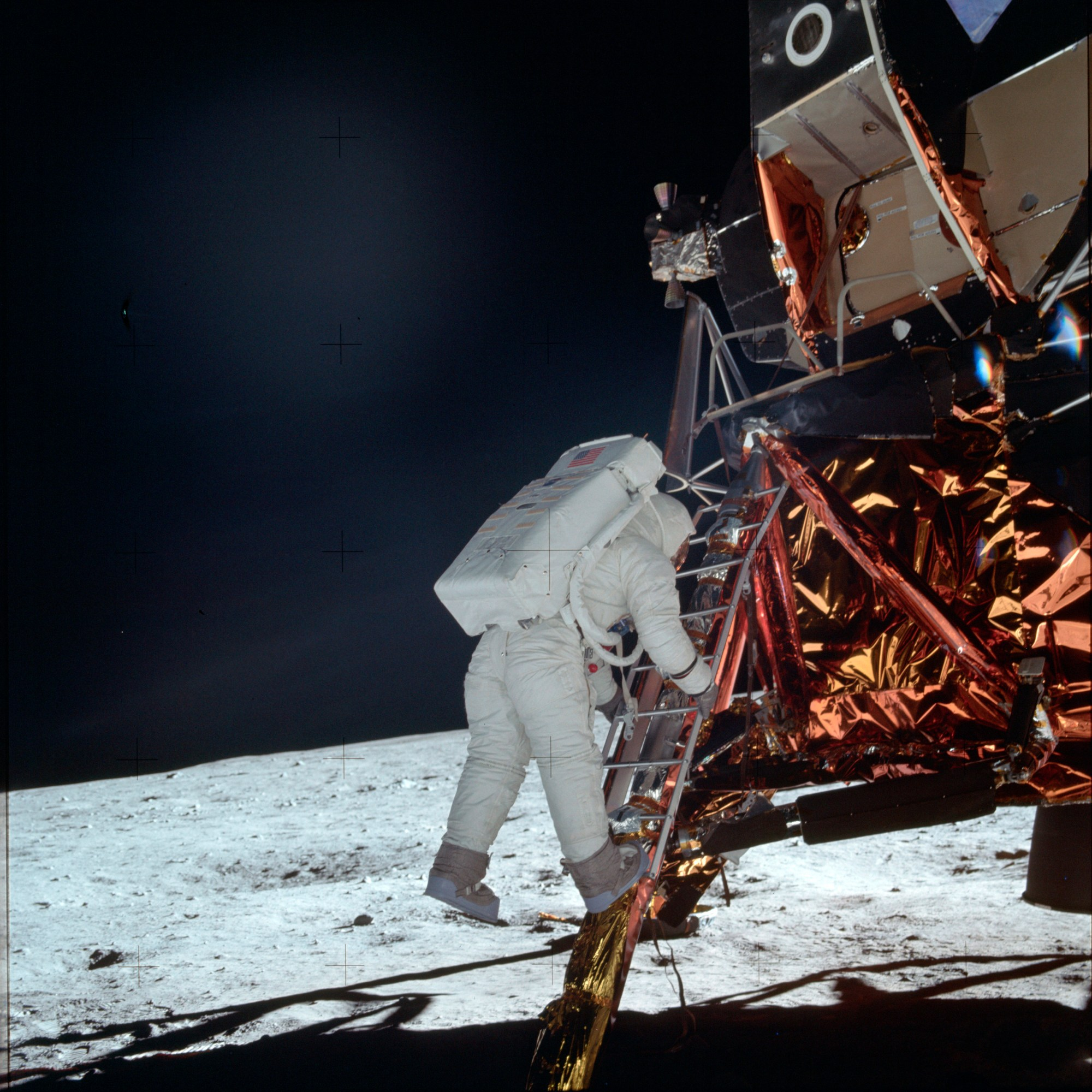In this July 20, 1969 photo made available by NASA, astronaut Buzz Aldrin Jr. descends a ladder from the Lunar Module during the Apollo 11 mission. (Neil Armstrong/NASA via AP)