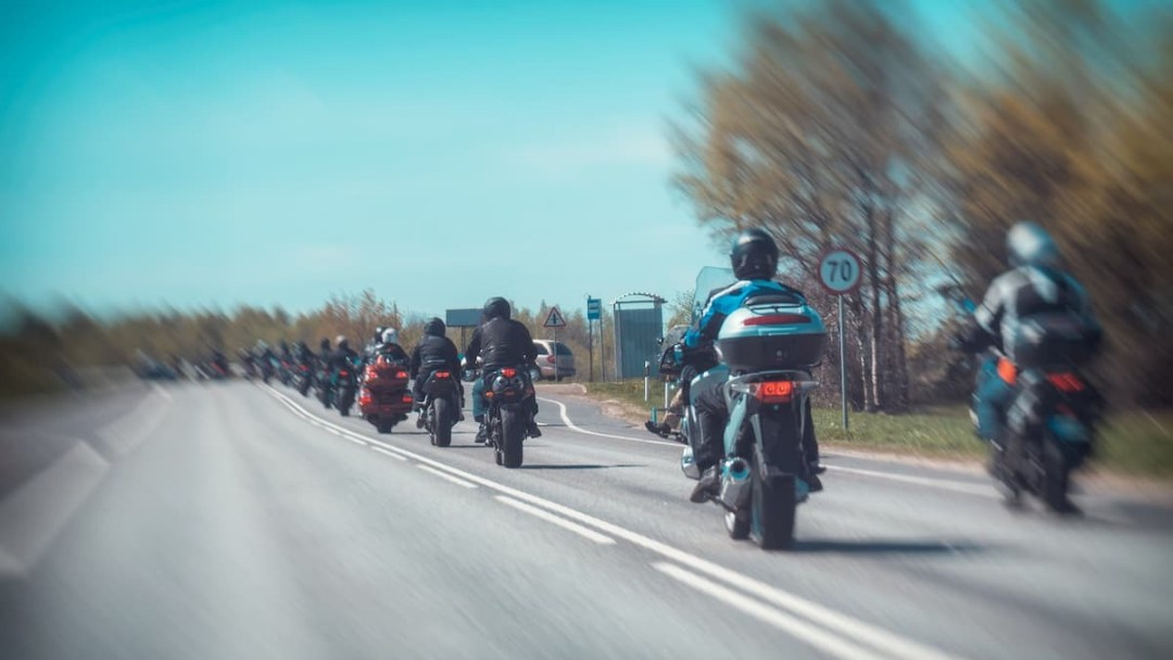 A trail of motorcyclists riding near Westport, Ontario.