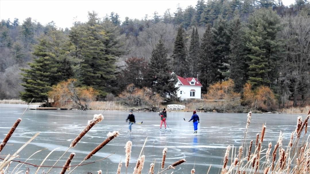 Children playing ice-hockey in Westport, Ontario.