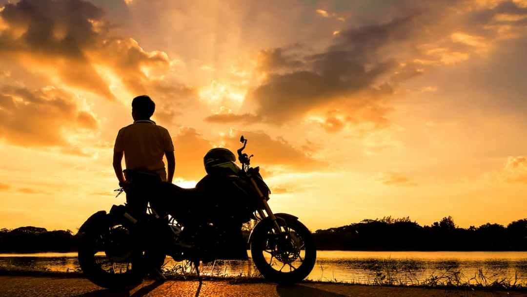 A motorcyclist enjoying the sunset close to Westport, Ontario.