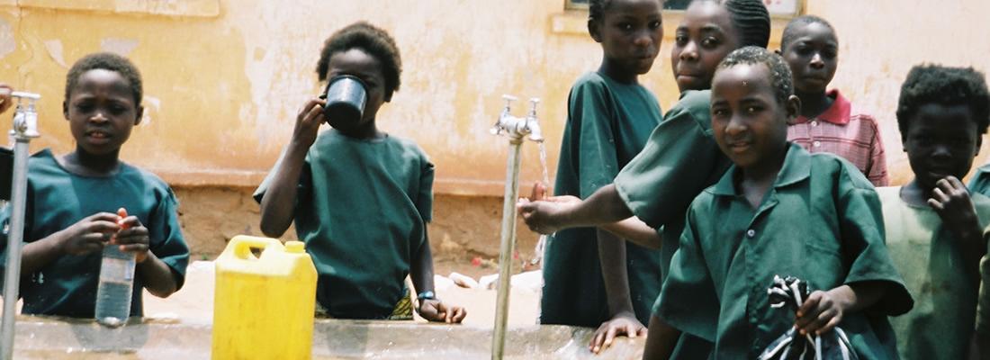 school children at the water taps