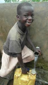 Boy using tap