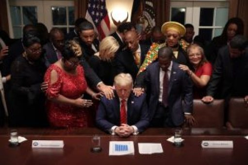 WASHINGTON, DC - FEBRUARY 27: African American supporters lay their hands on U.S. President Donald Trump as they pray for him at the conclusion of a news conference and meeting in the Cabinet Room at the White House February 27, 2020 in Washington, DC. The president talked about the economic advances African Americans have made under his administration, about the government's response to the global coronavirus threat and how dishonest he thinks the news media can be to him. He did not answer reporters' questions about the S&P 500 taking its worst loss in almost nine years. (Photo by Chip Somodevilla/Getty Images)