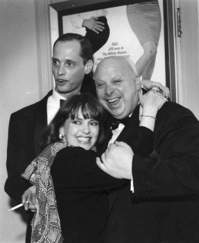 Director Waters and Divine cuddle up with famous casting agent Pat Moran in front of a Hairspray poster, weeks before the film premiered.