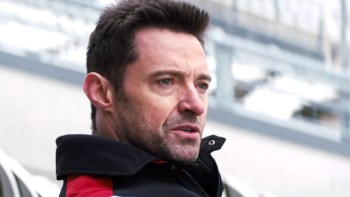 Hugh Jackman is equally handsome and bland as Eddie's coach.