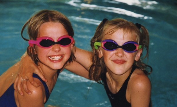 children swimming with goggles