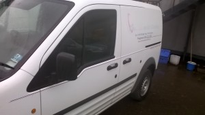 passenger side of the van , more vinyls and the old logo.