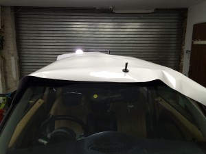 Vinyl Wrap is on the roof held by magnets.  Cutting a small hole and then feeding the Ariel so the vinyl goes under the ariel