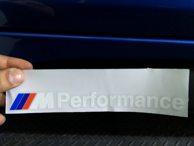 BMW M Performance Decal Badge ready to be applied on top of the vinyl