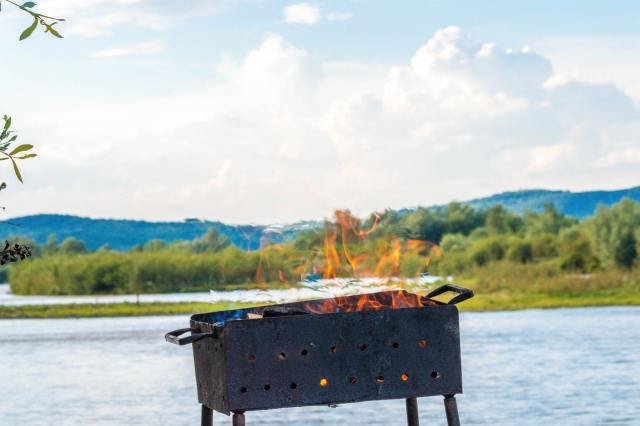 a black fire pit placed outdoors