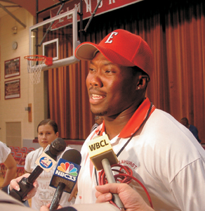 photo by rls Coach Roosevelt Norfleet talks to the press at Elmhurst High School pep rally on Monday, August 25, 2003.