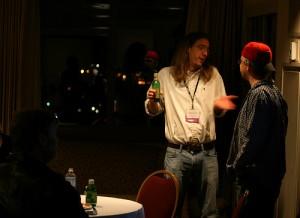 Man holding bottle shrugs