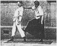Shihan Yoshinori (Yazo) Eguchi of Kyushin Ryu Jujitsu on the right, with Edward William Barton-Wright, performing a Jujitsu demonstration.