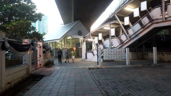The stairs leading down on the right of the photo is Exit 2. Follow the sheltered walkway to get to the pier.
