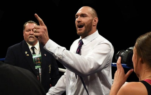 WBA/WBO champ Fury stormed the ring after Wilder's KO victory and created a WWE-like scene. (Photo: Getty Images)