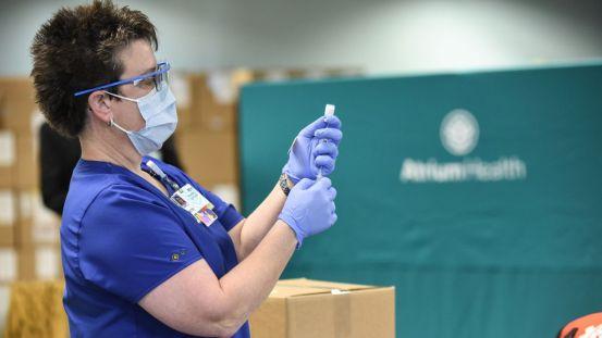 Atrium Health administering COVID-19 vaccine to non-critical employees, despite state regulations