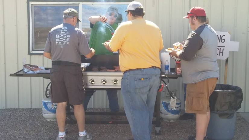 members serving at bbq event