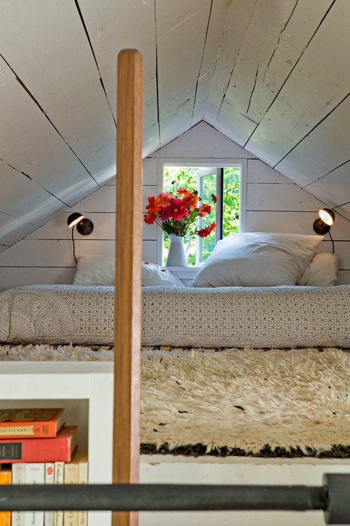 Lofted bed in tiny house.