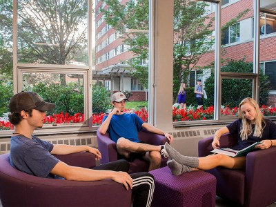 Students study in the common room of Scott Hall