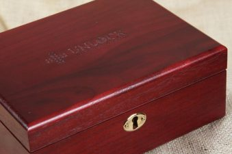 Cherry colored wooden box with lock