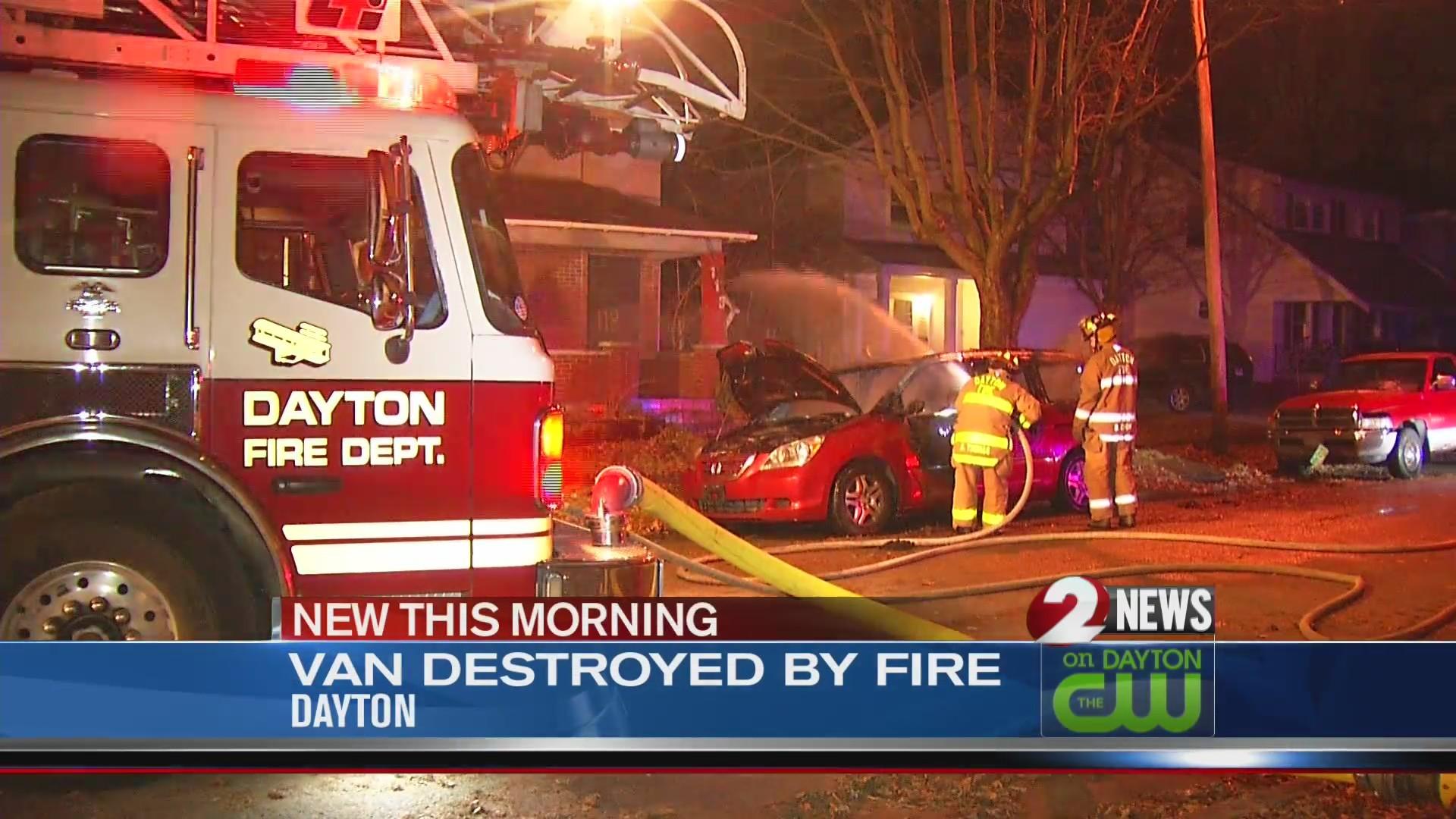 Van on street catches fire