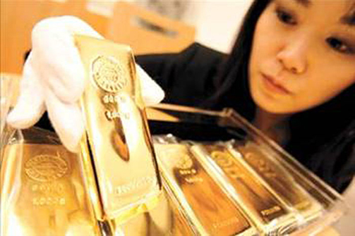 Chinese woman holding a gold bar 3