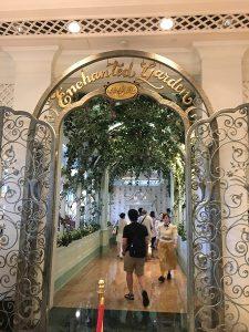 "alt=""Entrance to the Enchanted Garden Restaurant at Hong Kong Disneyland."""