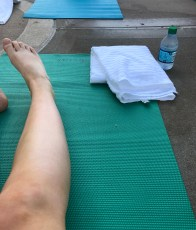 "alt=""Rise and Shine yoga swag -- a yoga mat, a towel, and a bottle of water."""