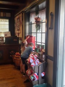 """alt=""""children writing letters to Santa Claus at Ye Olde Christmas Shoppe at the Magic Kingdom."""""""