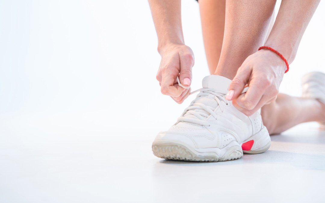 a person putting on supportive shoes