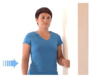 a woman puts her arm against wall