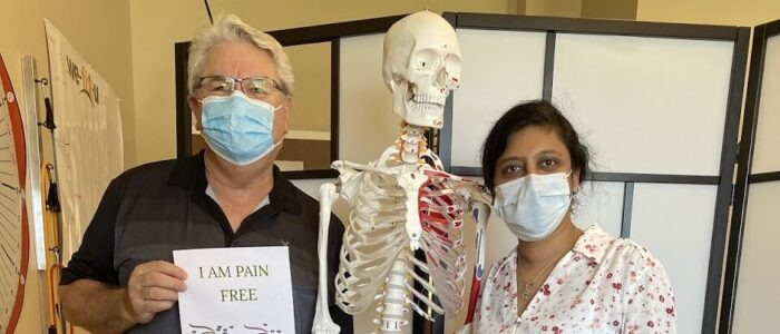 Osahwa Physiotherapist standing beside a recovered patient holding a graduation paper