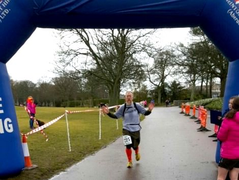 tim crossing the line after his ultra marathon