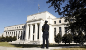 Prick asset bubbles with rates? Fed officials split