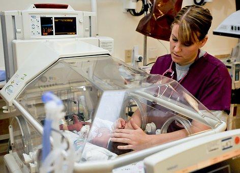 nurse with incubator_1494274921962.jpg