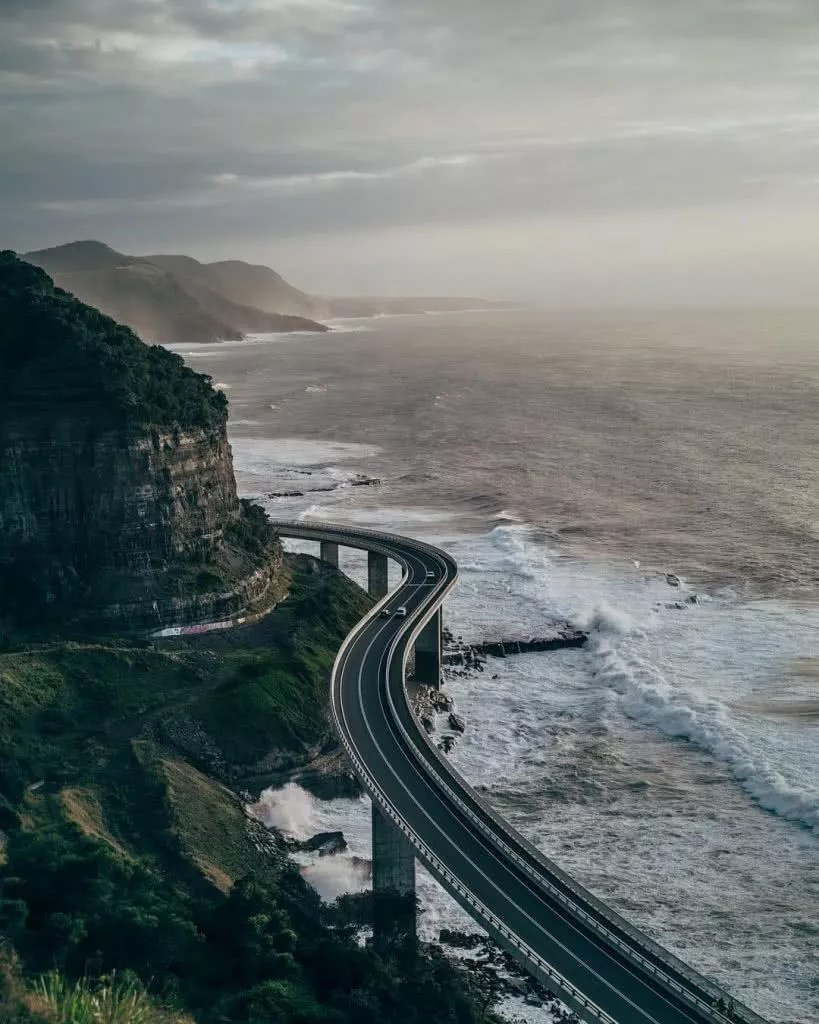 "Microadventures with @tk_north ""For me Sea Cliff Bridge combines the best of both words, stunning natural and manmade beauty together along the coastline. This shot taken on another early start with the gang to arrive for sunrise."" #weareexplorers"
