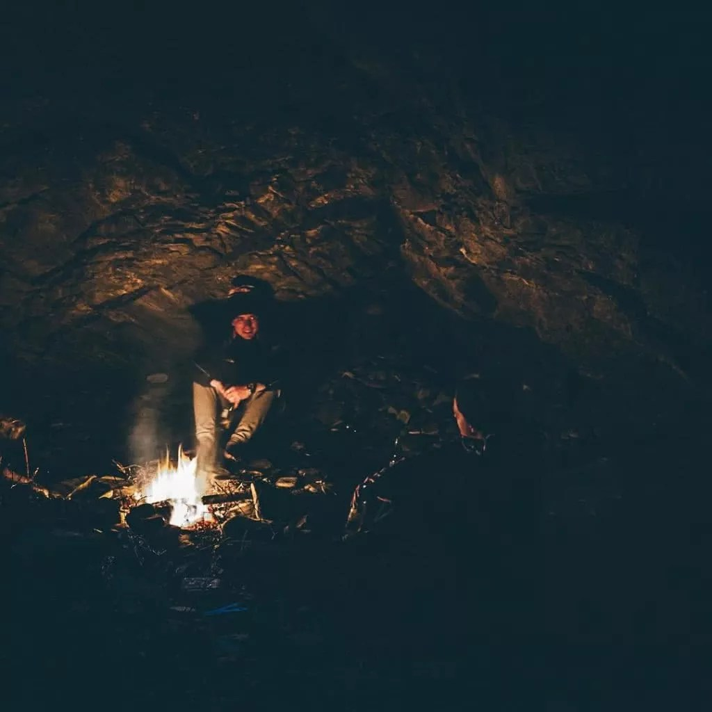 """Microadventures with @jackjbrookes 4/5 """"Sitting around a fire with your mates and just hanging out - it beats being on a couch staring at a screen in my opinion. This shot is from a mid-week winter getaway where we ventured down the coast, spent the night in the cave and were up to see the sunrise in the morning."""" #weareexplorers"""