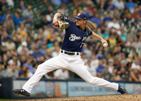 Cain HR, Brewers fan 16, beat Padres 5-1 to improve position