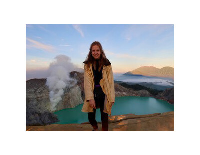 Picture of Amy in front of volcanic lake