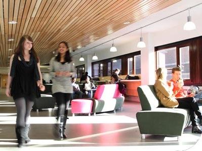 women walking through lobby