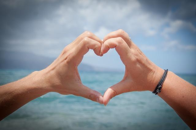Heart symbol made of hands