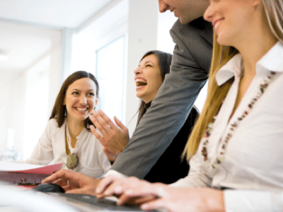 Laughing businesswoman at meeting