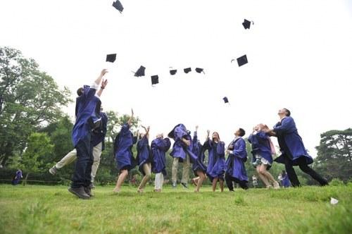 graduate students celebrating their graduation, university