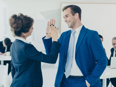 colleagues giving an office high-five featured