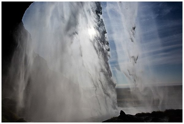 A picture from behind Seljalandsfoss waterfall in Iceland